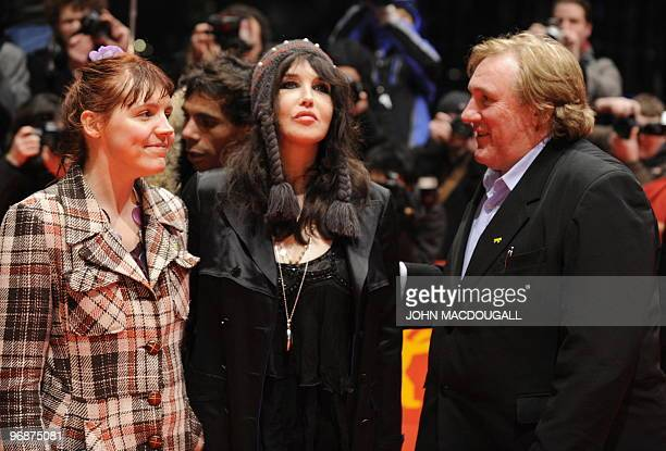 French actress Miss Ming French actress Isabelle Adjani and French actor Gerard Depardieu pose for photographers on the red carpet at the premiere...