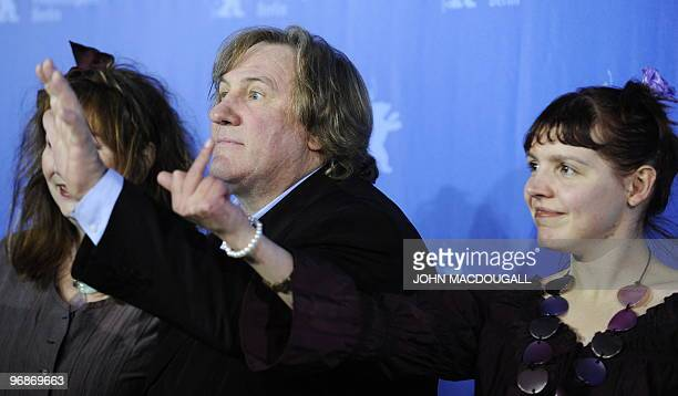 French actress Miss Ming gives the finger as French actor Gerard Depardieu waves during the photo call for the movie 'Mammuth' during the 60th...