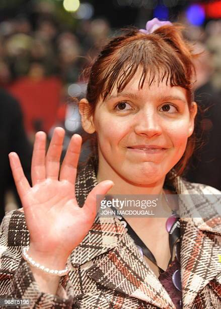 French actress Miss Ming poses for photographers on the red carpet at the premiere the movie 'Mammuth' during the 60th Berlinale Film Festival in...