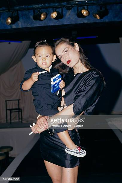 French actress model and singer Bambou with her son Lucien aka Lulu Gainsbourg attend a fashion show at Les Bains Douches Parisian nightclub