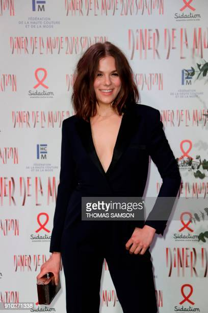 French actress Morgane Polanski poses upon arriving to the Diner de la Mode fundraiser dinner to benefit the French antiAIDS association Sidaction on...