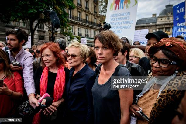 French actress Muriel Robin her partner Anne Le Nen and French actress Eva Darlan take part in a demonstration to denounce sexism and sexual violence...