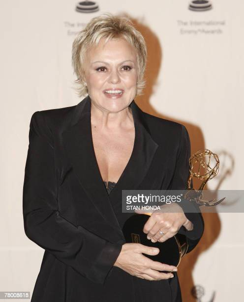 French actress Muriel Robin holds her award in the Best Performance by an Actress category at the 35th Annual International Emmy Awards 19 November...