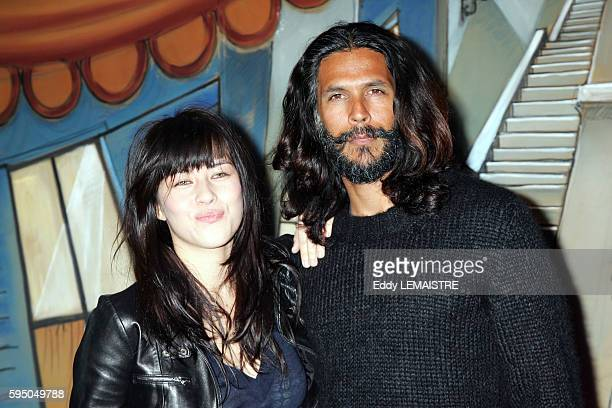French actress Mylene Jampenoi and Indian actor Milind Soman attend the 'La Mome' premiere in Paris