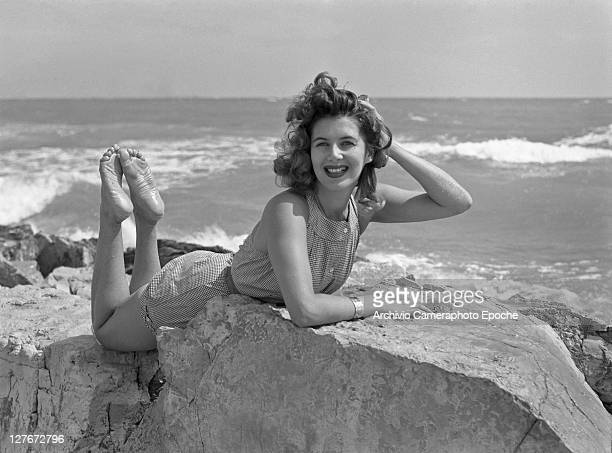French actress Myriam Bru lying on the rocks Lido Venice 1952