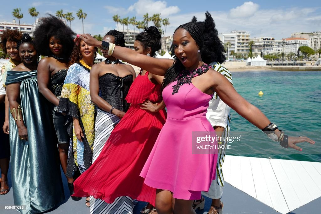 French actress Nadege Beausson-Diagne (R), a member of a group of 16 black women who fight for equality and inclusion of black women in the French film industry, dances on May 17, 2018 while posing with (fromR) French-Portuguese actress Sara Martins, French actress and writer Mata Gabin, French actress and producer France Zobda, French actress Maimouna Gueye, French-Cameroonian Marie-Philomene Nga and French writer Rachel Khan during a photocall for the book 'My Profession is Not Back' on the sidelines of the 71st edition of the Cannes Film Festival in Cannes, southern France.