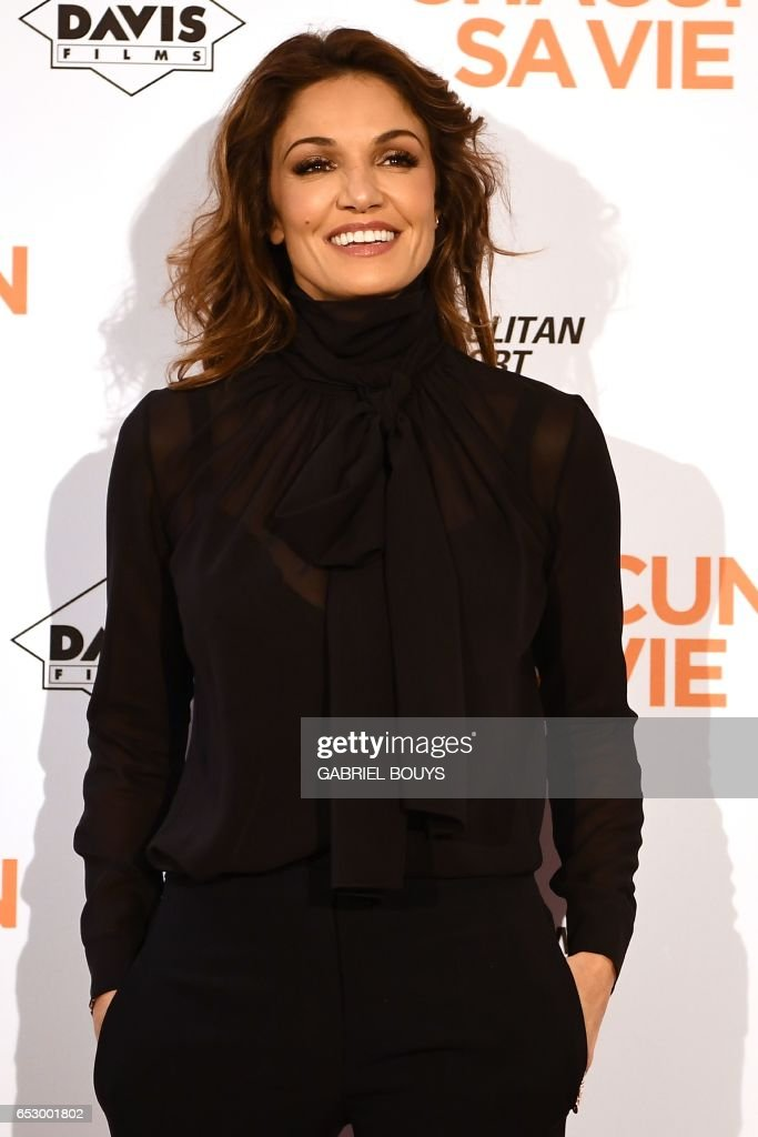French actress Nadia Fares poses during the photocall for the premiere of the film 'Chacun Sa Vie' in Paris on March 13, 2017. The film is directed by French director Claude Lelouch. /