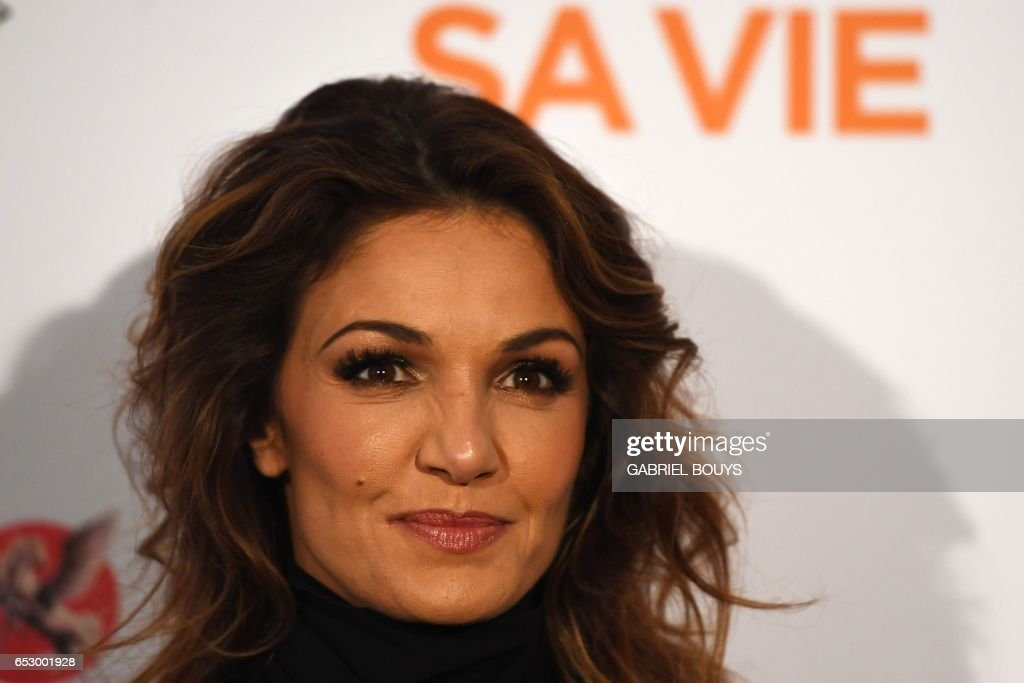 French actress Nadia Fares poses during the photocall for the premiere of the film 'Chacun Sa Vie' in Paris on March 13, 2017. The film is directed by French director Claude Lelouch
