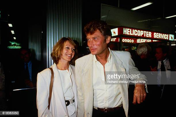 French actress Nathalie Baye and French singer Johnny Hallyday arrive at the airport in Cannes The couple is in Cannes for the 1984 Cannes Film...