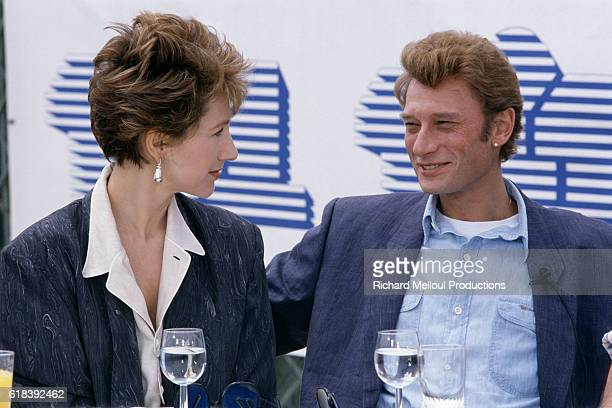French actress Nathalie Baye and her partner singer and actor Johnny Hallyday attend the 37th Cannes Film Festival to present the movie Detective...