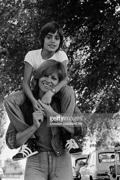 French actress Nathalie Delon relaxing with her son Anthony during the set of L'histoire très bonne et très joyeuse de Colinot TrousseChemise written...