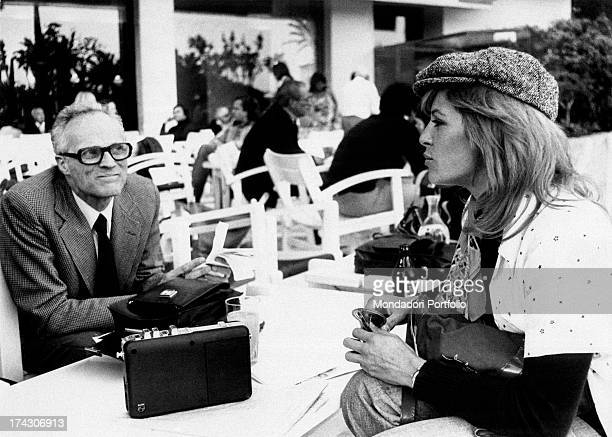 French actress Nathalie Delon talking to a man Cannes 1973