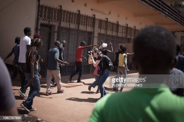 French actress Nina Meurisse who plays the part of photojournalist Camille Lepage performs in the middle of a demonstration scene in the streets of...