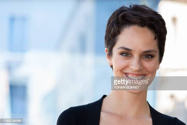 French actress Noemie Merlant pose during a photocall of the film Portrait de la jeune fille en feu during the 12th Francophone Angouleme Film...