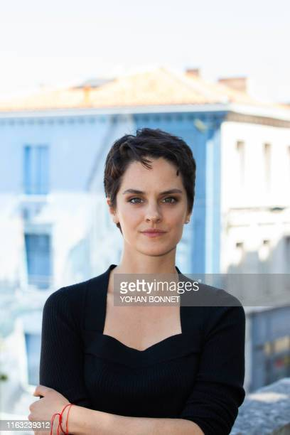 French actress Noemie Merlant poses during a photocall of the film Portrait de la jeune fille en feu during the 12th Francophone Angouleme Film...