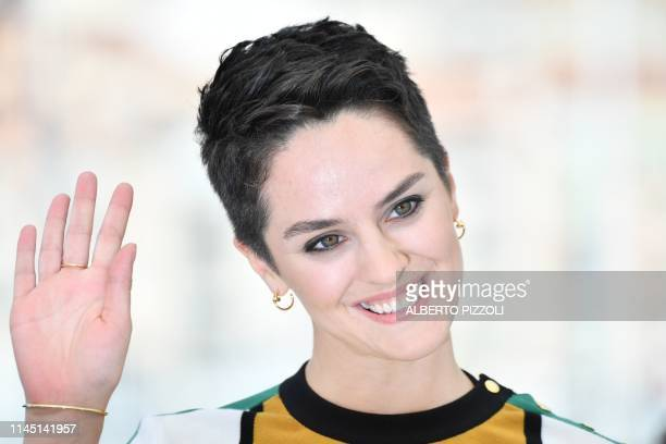 French actress Noemie Merlant waves during a photocall for the film Portrait Of A Lady On Fire at the 72nd edition of the Cannes Film Festival in...