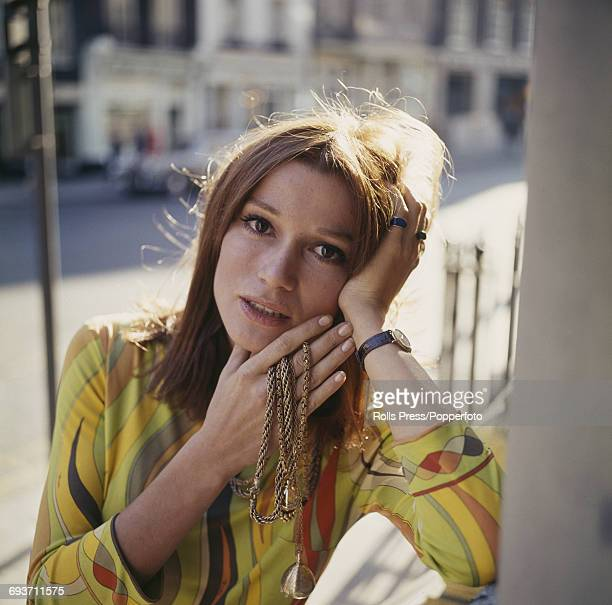 French actress Olga GeorgesPicot who appears in the film 'Adieu l'ami' pictured holding a metallic necklace in London on 22nd September 1969