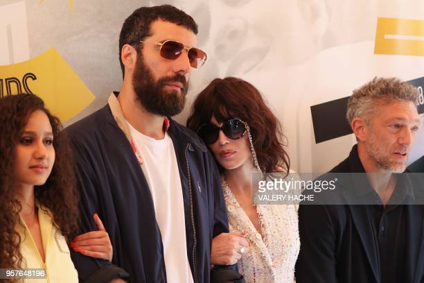 French actress Oulaya Amamra French director Romain Gavras French actress Isabelle Adjani and French actor Vincent Cassel pose on May 12 2018 during...