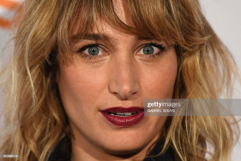French actress Pauline Lefevre poses during the photocall for the premiere of the film 'Chacun Sa Vie' in Paris on March 13, 2017. The film is directed by French director Claude Lelouch. /