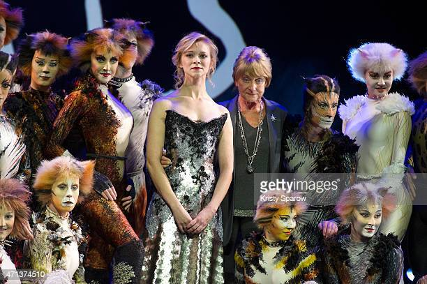 French actress Prisca Demarez and British choreographer Gillian Lynne pose with members of the cast during a press presentation of the musical 'Cats'...