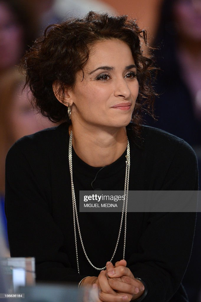 French actress Rachida Brakni takes part in the TV show 'Le grand journal' host by her husband former French football player turned actor Eric Cantona, on a set of French TV Canal+, on November 22,...