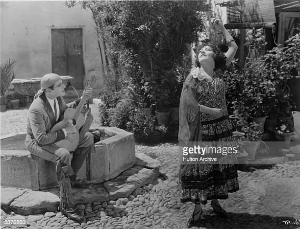 French actress Renee Adoree dances to the music of a Spanish guitar in a scene from the film 'The Bandolero' directed by Tom Terriss for MGM