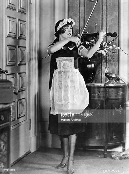 French actress Renee Adoree plays the violin dressed in a maid's outfit in the film 'On Ze Boulevard' Title On Ze Boulevard Studio MGM Director Harry...