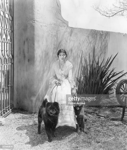 French actress Renee Adoree with her pet Chow dogs during a break in the making of the film 'The Tide of Empire' directed by Allan Dwan and produced...
