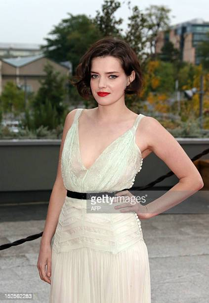 French actress Roxane Mesquida poses as she arrives to attend the inauguration ceremony of the Cite du cinema a film studios complex heralded as...