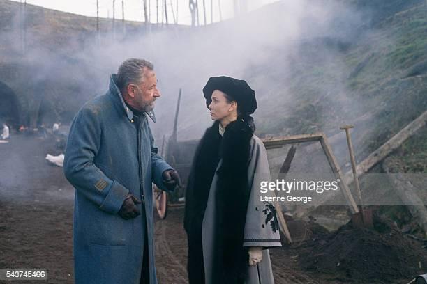 "French actress Sabine Azema and French actor Philippe Noiret on the set of Bertrand Tavernier's film ""La Vie et rien d'autre"" , for which Noiret won..."