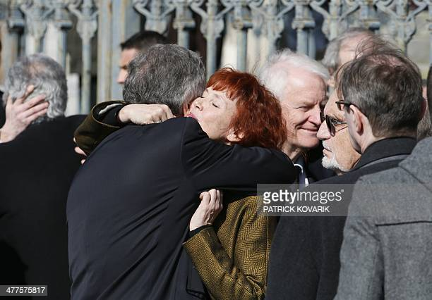 French actress Sabine Azema embraces a relative as she leaves SaintVincent de Paul church after attending the funeral ceremony of French director...