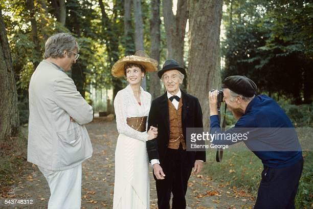 "French actress Sabine Azéma with actor and theater director Louis Ducreux being photographed by Robert Doisneau on the set of ""Un dimanche à la..."