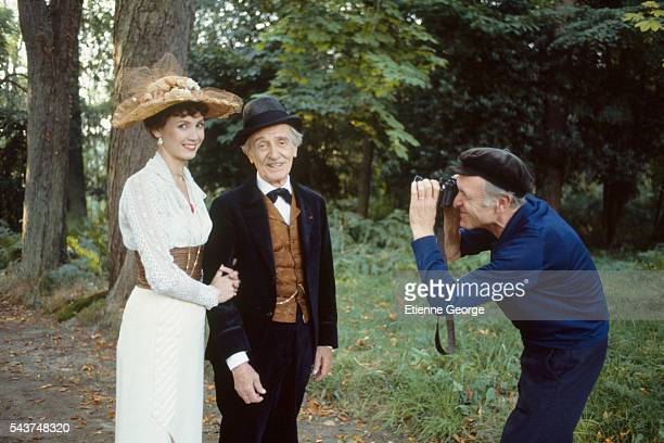 French actress Sabine Azéma with actor and theater director Louis Ducreux being photographed by Robert Doisneau on the set of 'Un dimanche à la...