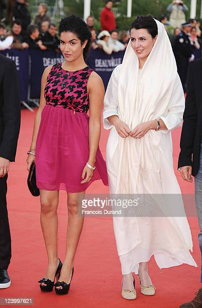 French actress Sabrina Ouazani and Iranian actress Leila Hatami arrive for 'The Conspirator' premiere during the 37th Deauville American Film...