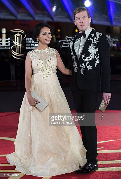 French actress Saida Jawad and fashion designer Christophe Guillarme attend the 16th Marrakech International Film Festival Opening Ceremony on...