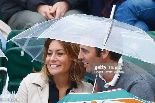 French actress Shirley Bousquet and her boyfriend Charles Watine attend the French Tennis Open Day Ten at Roland Garros on May 31 2016 in Paris France