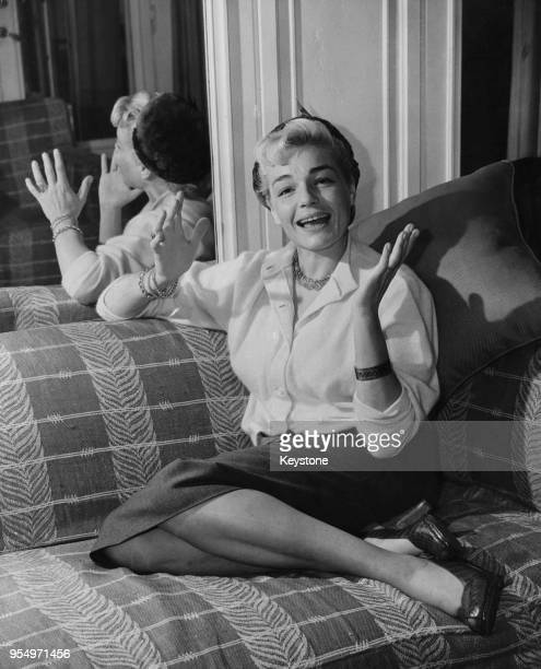 French actress Simone Signoret after her arrival in London 6th October 1952 She is in the UK to provide an Englishspeaking soundtrack for her part as...