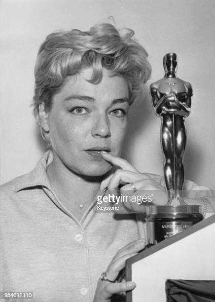 French actress Simone Signoret at her home in Paris France with the Best Actress Academy Award which she recently received for her role in the film...