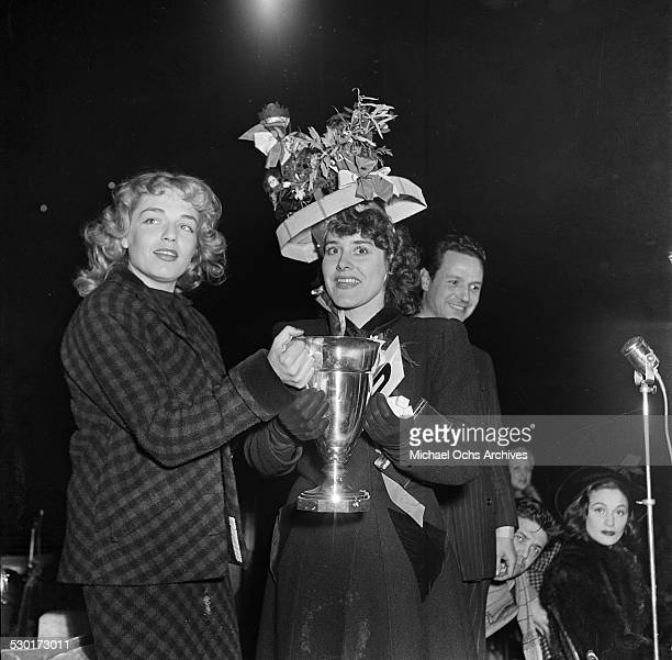 French actress Simone Signoret awards a trophy during an event in Los AngelesCA