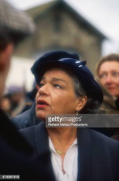 French actress Simone Signoret looks up during the filming of French director Pierre GranierDeferre's film L'Etoile du Nord in Cherbourg Director...
