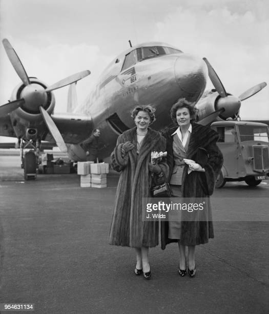 French actress Simone Simon and Italian actress Isa Miranda arrive at Northolt by air from Paris, for the premiere of their latest film 'La Ronde',...