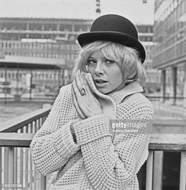 French actress Sophie Hardy filming the musical comedy 'Three Hats for Lisa', aka 'One Day in London' in London, UK, 16th October 1964.