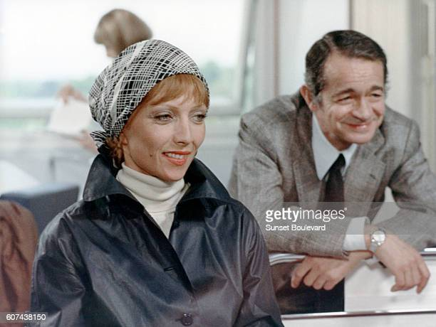French actress Stephane Audran and Italianborn French actor and singer Serge Reggiani on the set of Vincent François Paul et les autres based on the...