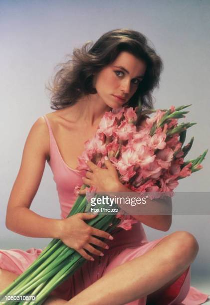 French actress Valérie Kaprisky holding a bouquet of gladioli 1985