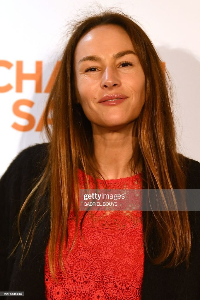 French actress Vanessa Demouy poses during the photocall for the premiere of the film 'Chacun Sa Vie' in Paris on March 13, 2017. The film is directed by French director Claude Lelouch. /