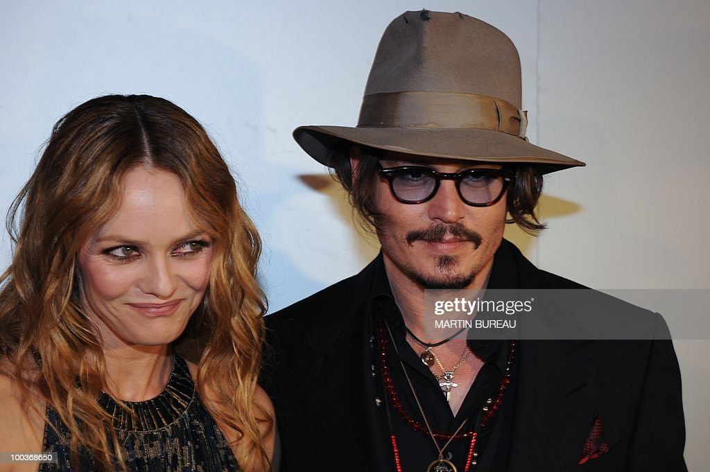 French actress Vanessa Paradis (L) and her husband, US actor Johnny Depp (R) arrive to attend the Figaro Madame/Chanel dinner during the 63rd Cannes Film Festival on May 18, 2010 in Cannes.