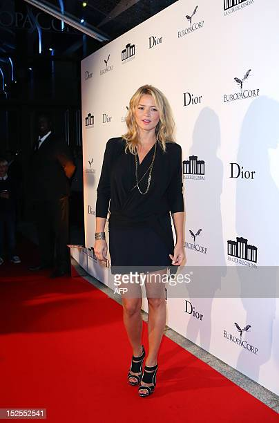 French actress Virginie Efira poses as she arrives to attend the inauguration ceremony of the Cite du cinema a film studios complex heralded as...