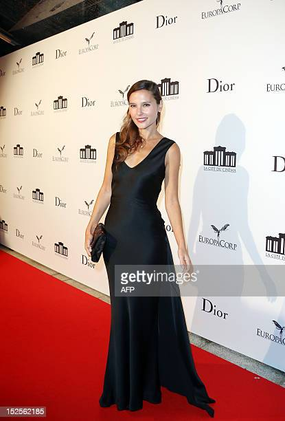 French actress Virginie Ledoyen poses as she arrives to attend the inauguration ceremony of the Cite du cinema a film studios complex heralded as...