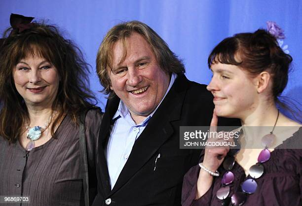 French actress Yolande Moreau French actor Gerard Depardieu and French actress Miss Ming pose for photographers during the photo call for the movie...