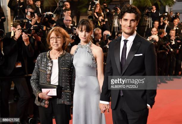 French actress/director and JeanLuc Godard's exwife Anne Wiazemsky FrenchBritish actress Stacy Martin and French actor Louis Garrel pose as they...